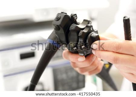 Gastrologist, modern endoscope. Doctor gastroenterologist with probe to perform gastroscopy and colonoscopy  - stock photo
