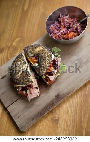 Gastronomic bagel on a wooden board - stock photo