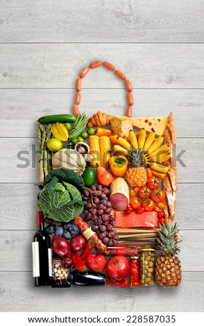 Gastronomy handbag / food photography of handbag made from different fruits and vegetables on wooden table  - stock photo