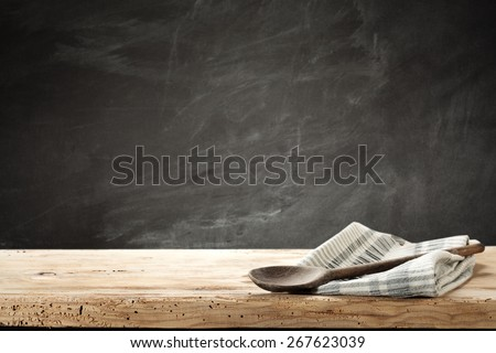 gastronomy spoon of wood and napkin  - stock photo