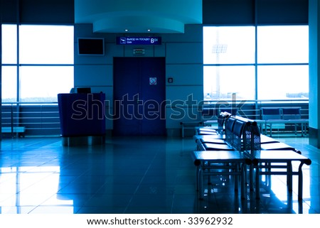 Gate B and empty seats, modern airport - stock photo
