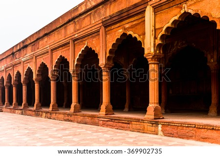 Gate for Taj Mahal (Crown of Palaces), an ivory-white marble mausoleum on the south bank of the Yamuna river in Agra.