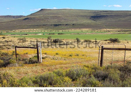 Gate leading to agricultural farmland in the Northern Cape of South Africa - stock photo