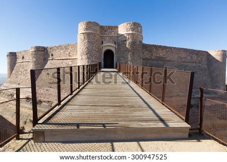 Gate of castle at mount.  Chinchilla de Monte-Aragon, province of Albacete, Spain - stock photo