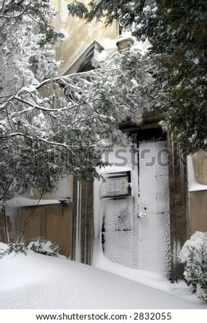 gate of church in snow