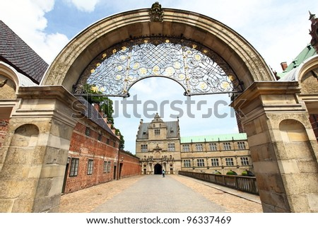 gate to Frederiksborg castle, the largest Renaissance palace in Denmark and Scandinavia - stock photo