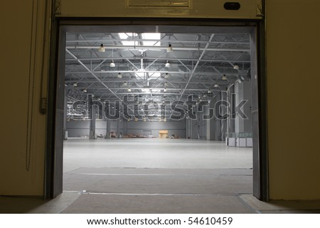 Gate to large modern storehouse - stock photo