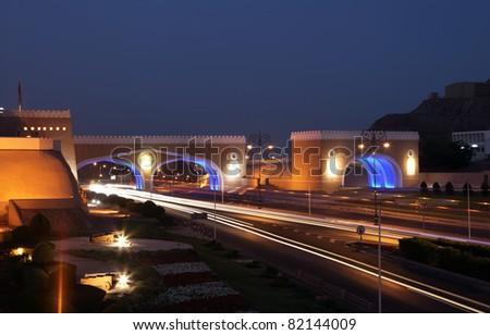 Gate to Muttrah, Illuminated at night. Muscat, Sultanate of Oman - stock photo