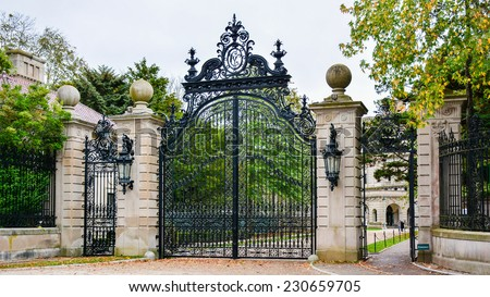 Gate to 'The Breakers', a Vanderbilt Mansion, a National Historic Landmark - Newport, Rhode Island - stock photo