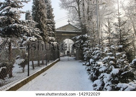 Gate to the historical cemetery in winter. Krakow, Poland