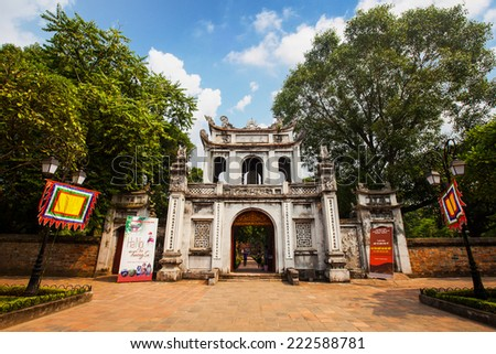 Gate to the Temple of Literature (Van Mieu) Unidentified tourists visiting the Van Mieu. The temple dedicated to Confucius was Vietnam's first National University. - stock photo