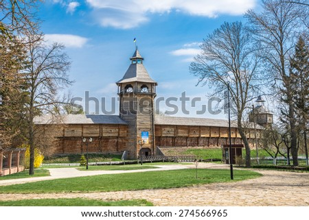 Gate tower and outer wall of the Baturin Citadel - wooden cossac's fortification. Baturin, Ukraine.  The poster on the gates tower contains the text of the pray for Ukraine. - stock photo