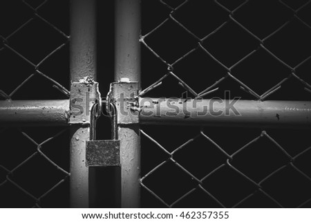 gate with a lock in the dark background