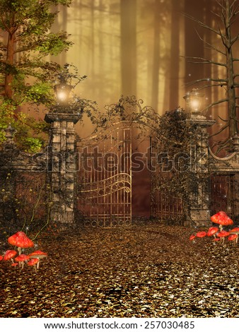 Gate with lamps and ivy to an autumn forest - stock photo