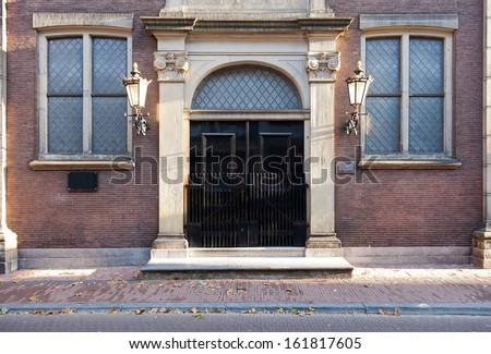 Gated entrance in the historical Dutch city of Utrecht. - stock photo