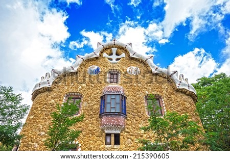 Gatehouse at the main entrance to Park Guell, which were originally designed as The Caretakers House. Barcelona, Spain. Park Guell (1914) is the famous architectural town art designed by Antoni Gaudi - stock photo