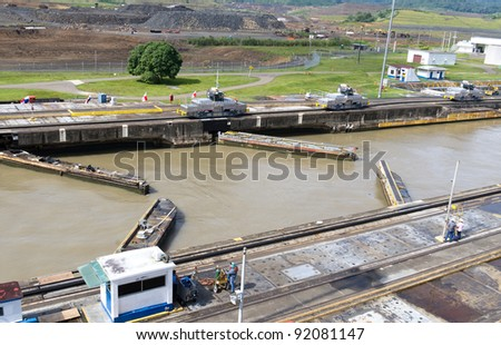 Gates and basin of Pedro Miguel Locks in Panama Canal opening to pass ships - stock photo