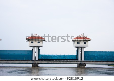 Gates in the evening. Block water to flow through slowly. The trees and nature. - stock photo