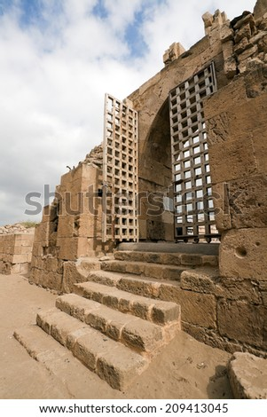 Gates to old crusaders castle of 13th century into the sea in Saida, Lebanon - stock photo
