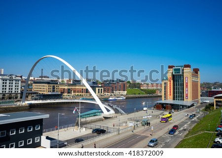 GATESHEAD, ENGLAND - AUGUST 6th: Gateshead Millennium Bridge with the Baltic Centre for Contemporary Art. The bridge spans the River Tyne in north east England on August 6, 2015.