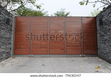 Gateway and Drive of a Luxury Suburban House with Plenty of Copy Space - stock photo