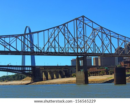 Gateway arch, eads bridge, and martin luther king bridge as seen from the Mississippi River, in     st louis, missouri         - stock photo