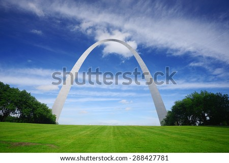 gateway arch in Saint Louis with blue sky and clouds - stock photo