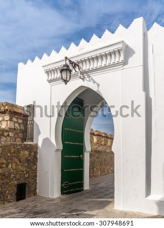 Gateway in the ancient medina of Asilah, north of Morocco - stock photo