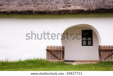Gateway of old Hungarian farmer's house - stock photo