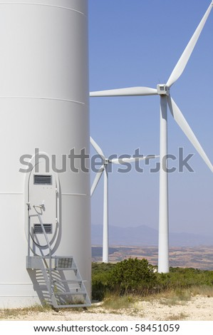 gateway to a modern windmill for renewable energy production - stock photo