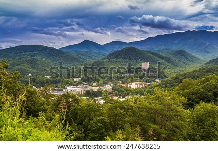 Gateway To The Smokies. The popular resort town of Gatlinburg, Tennessee nestled in the shadows of the Great Smoky Mountains. - stock photo