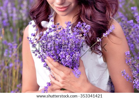 Gathering a bouquet of lavender - stock photo