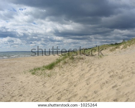 Gathering Clouds on the Shore of Lake Michigan - stock photo