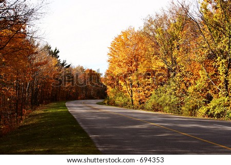 Gatineau Park Road in October - stock photo