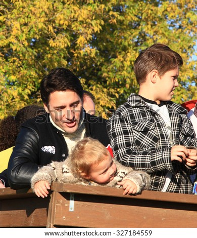GATINEAU, QUEBEC, CANADA - OCTOBER 13, 2015: Liberal leader Justin Trudeau and sons Hadrien (L) and Xavier (R).  - stock photo