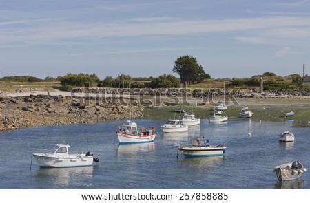 GATTEVILLE-LE-PHARE, FRANCE - JULY 1, 2011: Fishing and recreational boats at low tide in the harbor of Gatteville-le-Phare, France. Gatteville-le-Phare is a picturesque fishing village. - stock photo