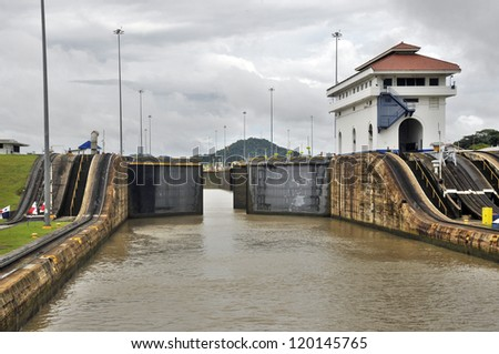 GATUN LOCKS - PANAMA CANAL-NOV. 7:This is the first set of locks situated on the Atlantic entrance of the Panama Canal. On nov. 7 2012 in Panama. Ships are raised a total of 87 feet above sea. - stock photo