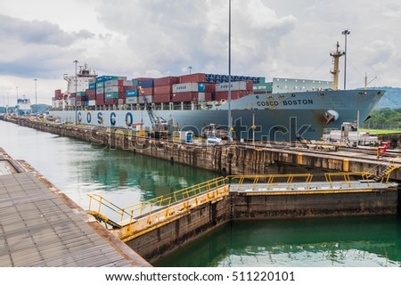 GATUN, PANAMA - MAY 29, 2016: Container ship passes through Gatun Locks, part of Panama Canal.