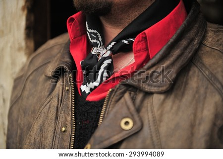 Gaucho, traditional cowboy In Latin America with red scarf and silver accessory