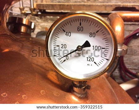 gauge on copper tank - stock photo