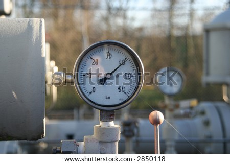 Gauges, tanks and tubes belonging to a control and conditioning station for natural gas - stock photo