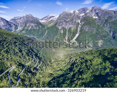Gaularfjellet mountain pass in Norway surrounded by magnificent mountains - stock photo