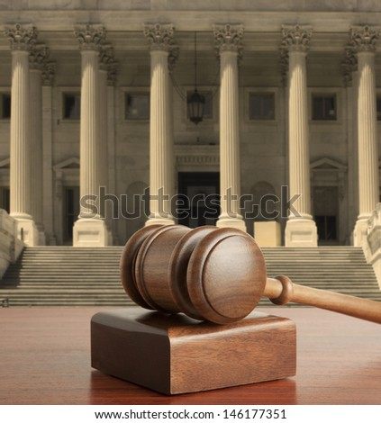 Gavel against the background of United States Capitol - stock photo