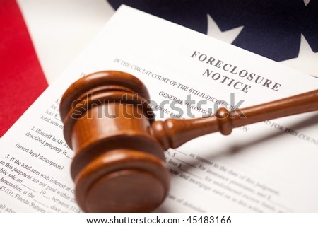 Gavel, American Flag and Foreclosure Notice with Selective Focus. - stock photo