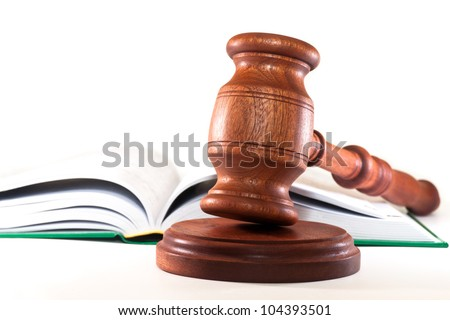 Gavel and a book on a white background - stock photo