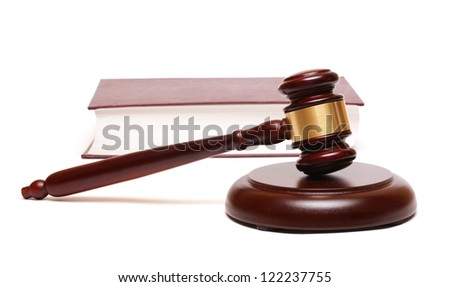 gavel and a thick book - stock photo