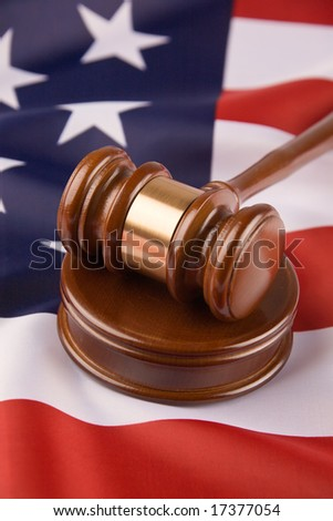 Gavel and american flag, symbol for jurisdiction - stock photo