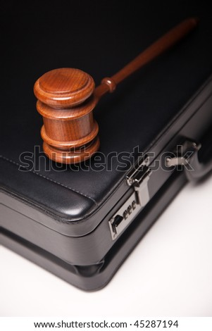 Gavel and Black Briefcase on Gradated Background with Selective Focus - Business Law Concept. - stock photo