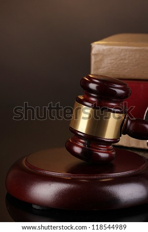 Gavel and books on law isolated on black close-up