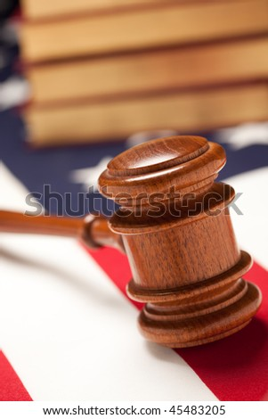 Gavel and Books on the American Flag with Selective Focus. - stock photo